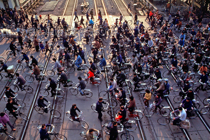 Beijing, China: bicycles crossing the railway - photo by B.Henry